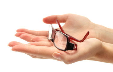 glasses on female hands, isolated on white