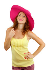 Smiling beautiful girl in beach hat isolated on white