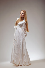 Portrait of elegant fashion woman in medieval era dress.