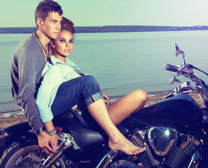 Fototapete - Romantic couple family resting on lake shore - motorbike