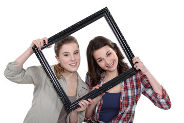 Teen behind black frame