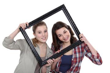 Teen behind black frame