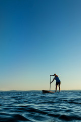 Woman on Stand Up Paddle Board at Sunset