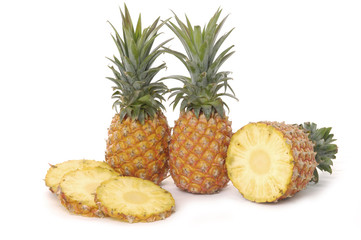 Set of fresh ripe pineapples close up