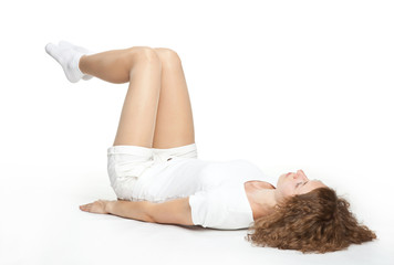 Sporty young woman doing gymnastics on the floor