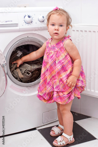 """""""little baby reaching washed things out of washing machine ..."""