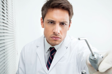 Dentist Holding Water Spraying Tool