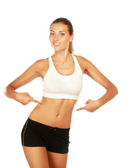 A woman showing her slim waist, isolated on white background