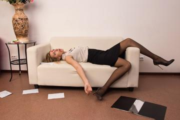 Lifeless business woman lying on sofa (imitation)