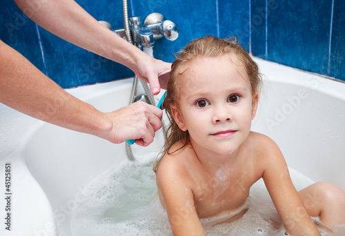 "Cute 12 Year Old Girls cute four year old girl taking a relaxing bath with foam"" stock"