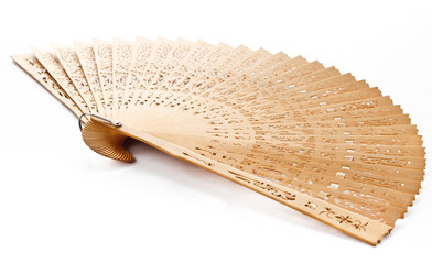 A hand fan made ??of wood from China