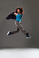 Young woman dancer jumping.
