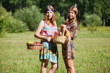 Young girls with a fruit basket