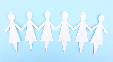 Paper people on blue background