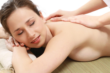 Closeuo of an attractive young woman receiving massage