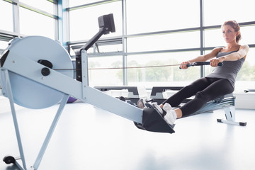 Fit woman training on row machine