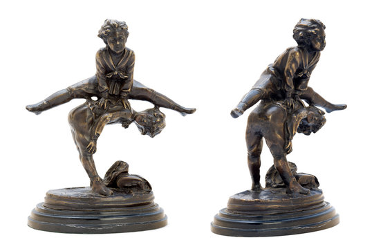 Antique bronze figurine with boys playing leapfrog.