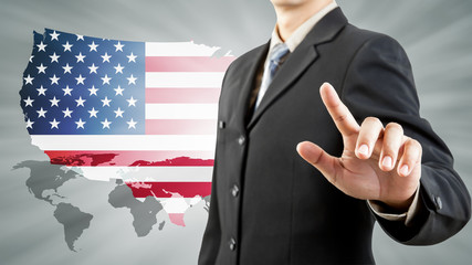 businessman hand pushing and USA world background