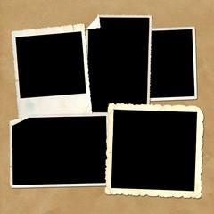 Old vintage photo frames on cardboard background
