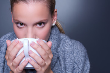 Attractive woman with hot drink.