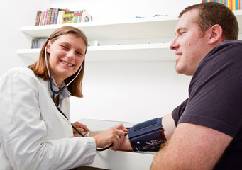 Blood pressure measuring. Doctor and patient.