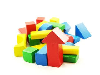 Pile of colorful wooden bricks, isolated towards white