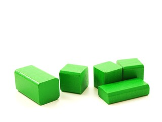 Wooden brick pieces of green color, isolated towards white
