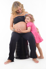 pregnant woman and daughter together
