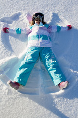 Winter fun - Snow Angel - lovely girl playing in snow