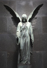 Stores photo Cimetiere Monument of old angel on cemetery in Warsaw