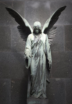 Monument of old angel on cemetery in Warsaw