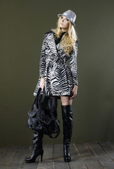 Full body beautiful casual young woman with bag shot in studio