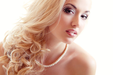 beauty portrait of young woman bride with beautiful makeup and a