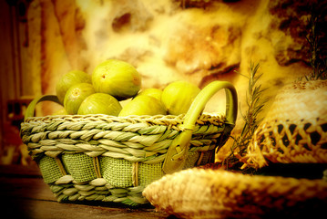 basket of figs and straw hat