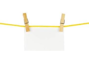 paper hang on clothesline with clipping path