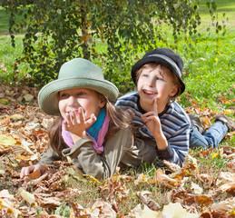 Happy girl and boy  enjoying autumn season