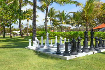 Large outdoor chess board on the grass