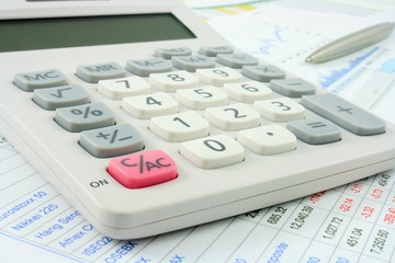 calculator on financial documents