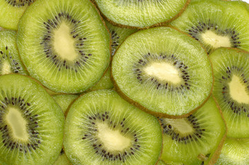 Tuinposter Plakjes fruit kiwi slices