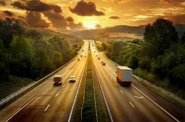 Aluminium Prints Night highway Highway trafin in sunset