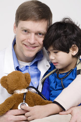Friendly doctor playing with five year old disabled patient