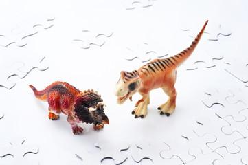 恐竜とパズルのピース
