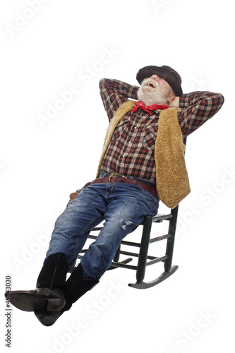 Laughing Old Cowboy Leans Back In Rocking Chair Stock Photo And