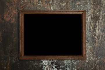 Fototapete - Picture frame on stained concrete background