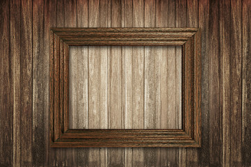 Fototapete - Wooden picture frame on wooden wall