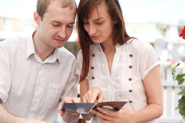 Young couple looking at menu  in cafe