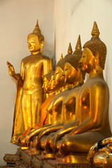 Group of Buddhas in the wall at church .