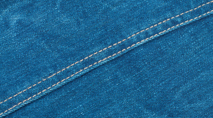Denim background with a diagonal seam