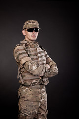 Military man on a black background