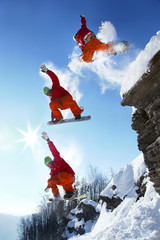 Wall Mural - The whole jump of Snowboarder from the rock in mountains